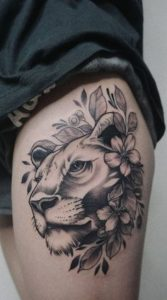 Female Lion Tattoo With Flowers