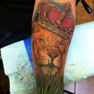 Realistic Lion With Crown Tattoo