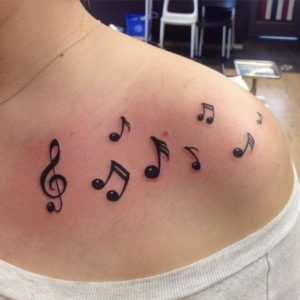 Scattered Music Note Tattoo