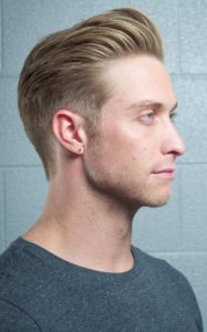 combed back puffed hairstyle for thin hair men