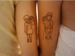 Best friend tattoos guy and girl